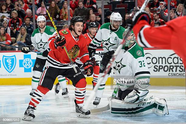 Andrew Shaw of the Chicago Blackhawks reacts after the Blackhawks scored against the Dallas Stars in the third period of the NHL game at the United...