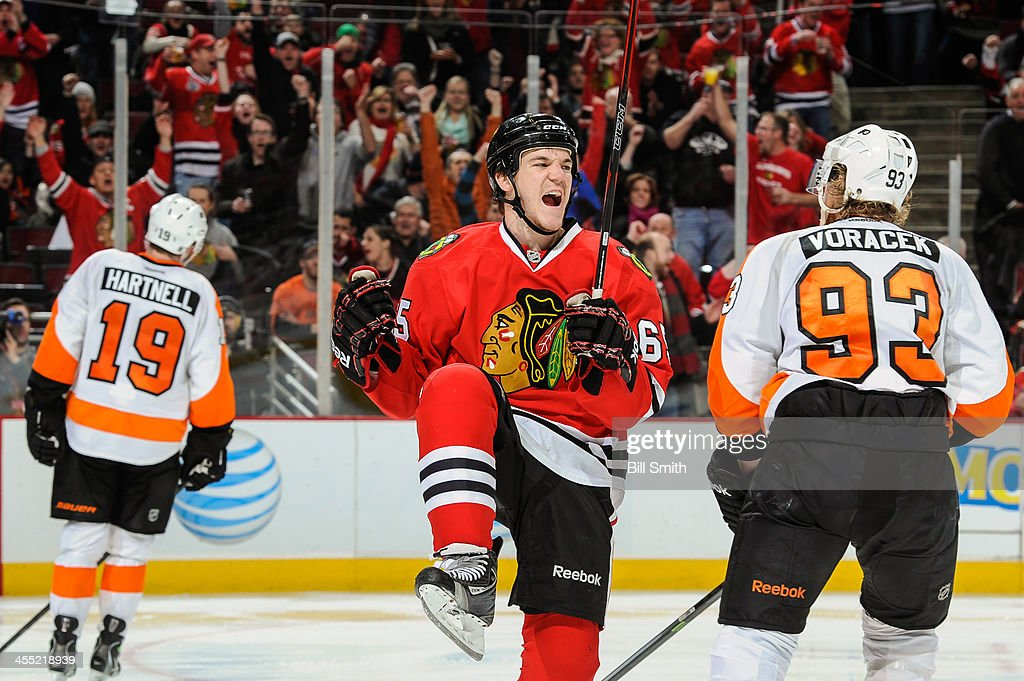 Andrew Shaw #65 of the Chicago Blackhawks reacts next to <a gi-track='captionPersonalityLinkClicked' href=/galleries/search?phrase=Jakub+Voracek&family=editorial&specificpeople=4111797 ng-click='$event.stopPropagation()'>Jakub Voracek</a> #93 of the Philadelphia Flyers after scoring in the second period during the NHL game on December 11, 2013 at the United Center in Chicago, Illinois.