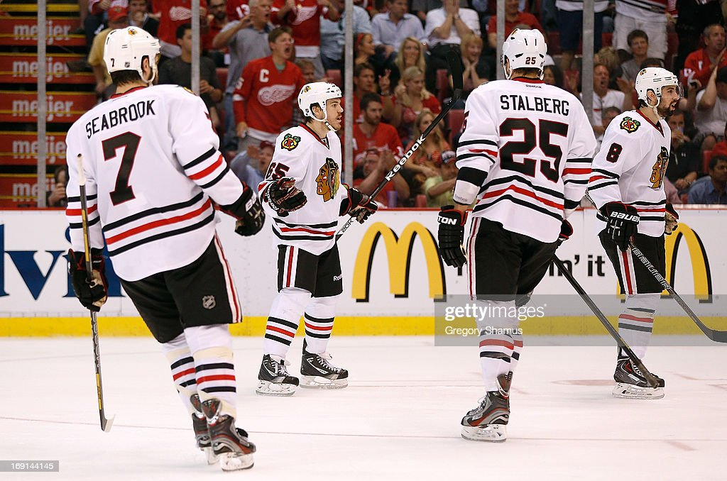 Andrew Shaw #65 of the Chicago Blackhawks reacts to a third period goal being waved off with teammates Brent Seabrook #7, Viktor Stalberg #25 and Nick Leddy #8 against the Detroit Red Wings in Game Three of the Western Conference Semifinals during the 2013 NHL Stanley Cup Playoffs at Joe Louis Arena on May 20, 2013 in Detroit, Michigan. Detroit won the game 3-1 to take a 2-1 series lead.