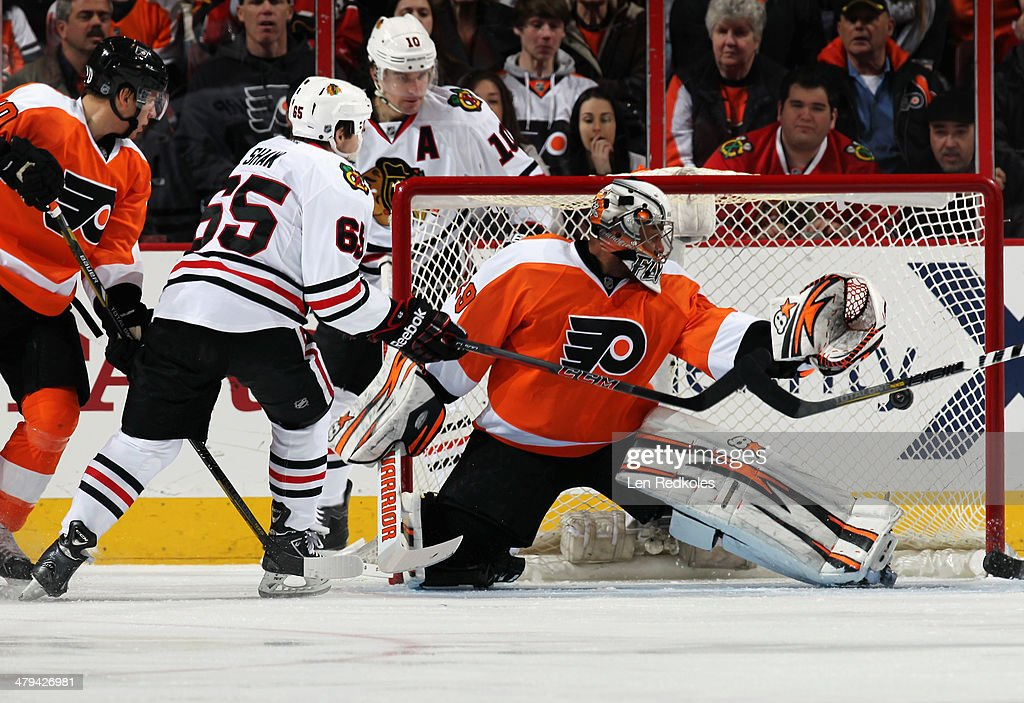 Andrew Shaw #65 of the Chicago Blackhawks scores a first period goal against <a gi-track='captionPersonalityLinkClicked' href=/galleries/search?phrase=Ray+Emery&family=editorial&specificpeople=218109 ng-click='$event.stopPropagation()'>Ray Emery</a> #29 of the Philadelphia Flyers on March 18, 2014 at the Wells Fargo Center in Philadelphia, Pennsylvania.