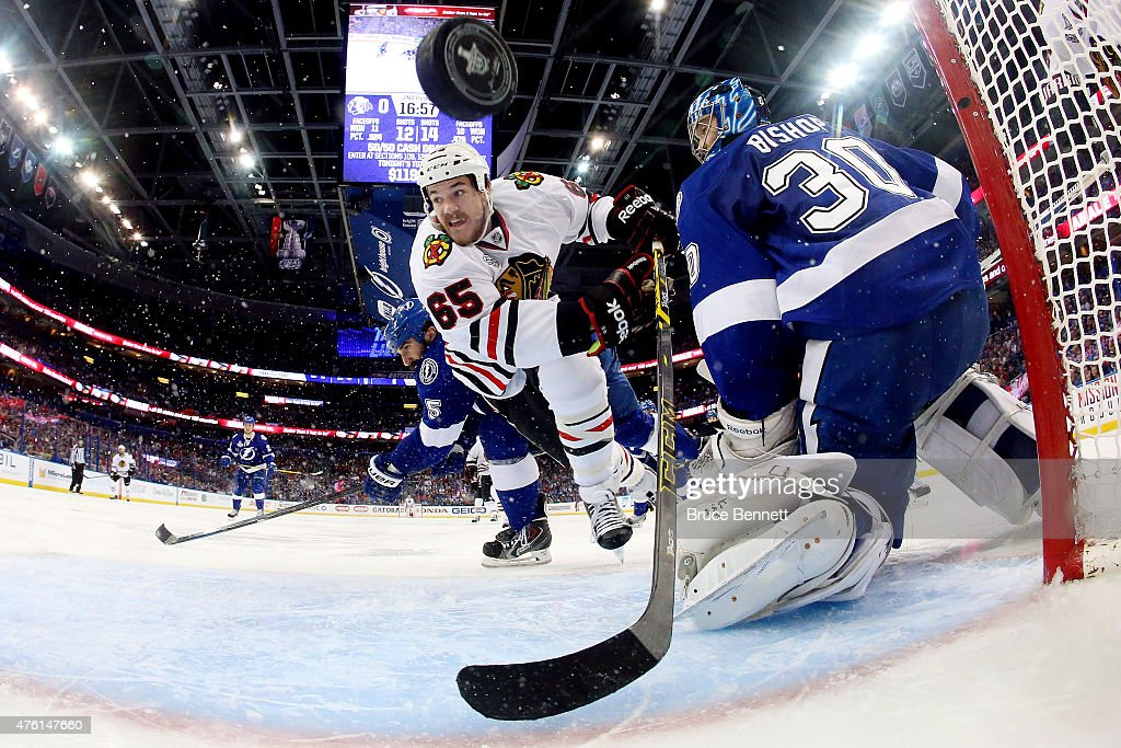 Andrew Shaw #65 of the Chicago Blackhawks scores a goal against Ben Bishop #30 of the Tampa Bay Lightning during the second period in Game Two of the 2015 NHL Stanley Cup Final at Amalie Arena on June 6, 2015 in Tampa, Florida.
