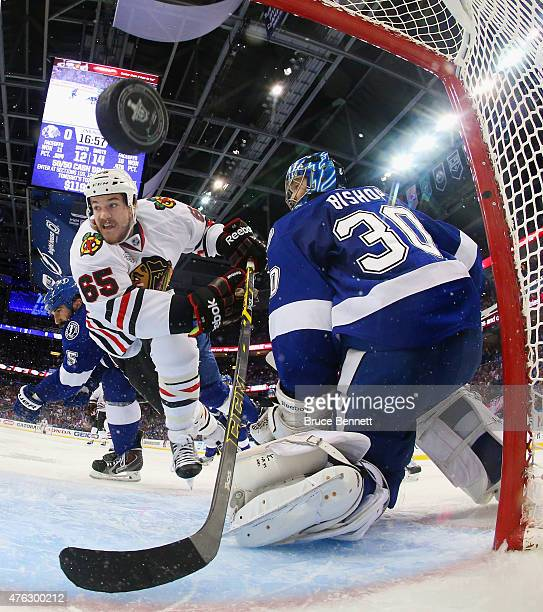 Andrew Shaw of the Chicago Blackhawks scores a goal against Ben Bishop of the Tampa Bay Lightning during the second period in Game Two of the 2015...
