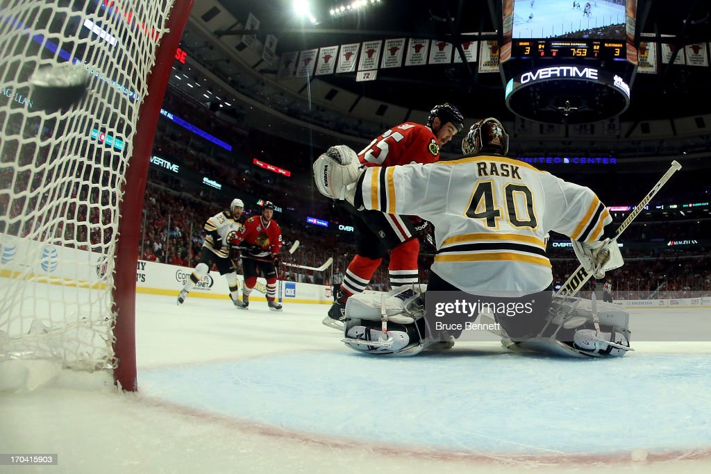 Andrew Shaw #65 of the Chicago Blackhawks scores the game-winning goal in the third overtime to against goalie Tuukka Rask #40 of the Boston Bruins to give the Bruins a 4-3 win in Game One of the NHL 2013 Stanley Cup Final at United Center on June 12, 2013 in Chicago, Illinois.