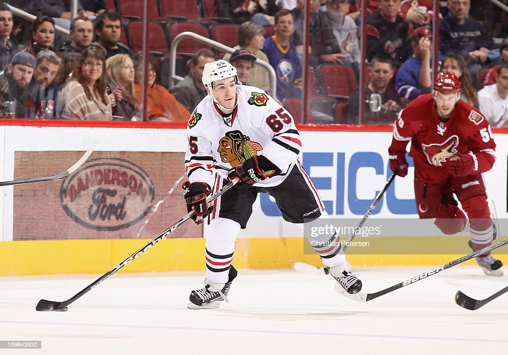 Andrew Shaw #65 of the Chicago Blackhawks skates with the puck during the NHL game against the Phoenix Coyotes at Jobing.com Arena on January 20, 2013 in Glendale, Arizona. The Blackhawks defeated the Coyotes 6-4.