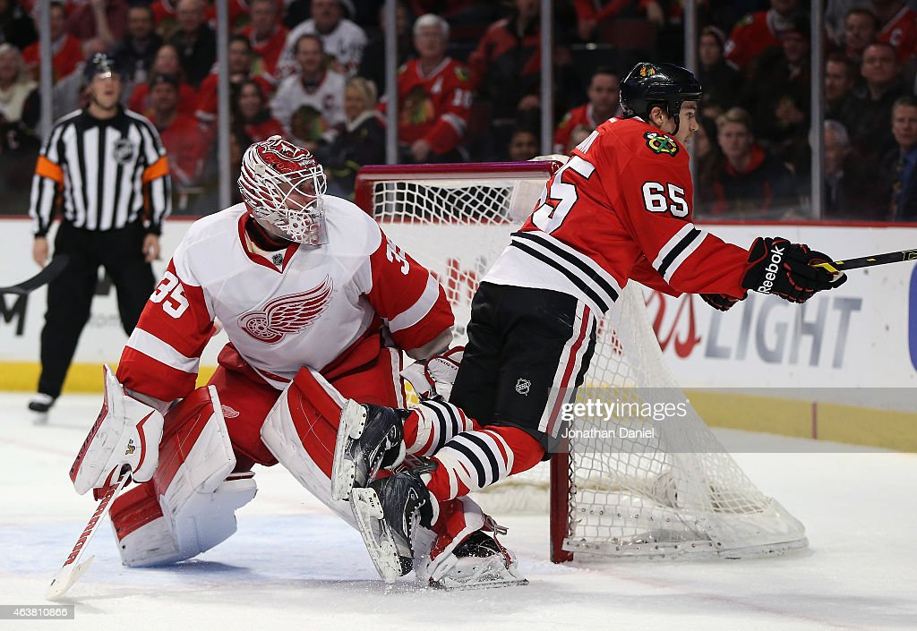 <a gi-track='captionPersonalityLinkClicked' href=/galleries/search?phrase=Andrew+Shaw+-+Ice+Hockey+Player&family=editorial&specificpeople=10568695 ng-click='$event.stopPropagation()'>Andrew Shaw</a> #65 of the Chicago Blackhawks trips over <a gi-track='captionPersonalityLinkClicked' href=/galleries/search?phrase=Jimmy+Howard&family=editorial&specificpeople=2118637 ng-click='$event.stopPropagation()'>Jimmy Howard</a> #35 of the Detroit Red Wings at the United Center on February 18, 2015 in Chicago, Illinois.