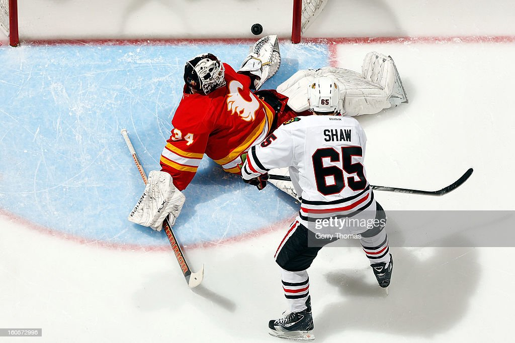 Andrew Shaw #65 of the Chicago Blackhawks watches a puck cross the goal line against <a gi-track='captionPersonalityLinkClicked' href=/galleries/search?phrase=Miikka+Kiprusoff&family=editorial&specificpeople=171703 ng-click='$event.stopPropagation()'>Miikka Kiprusoff</a> #34 of the Calgary Flames on February 2, 2013 at the Scotiabank Saddledome in Calgary, Alberta, Canada.