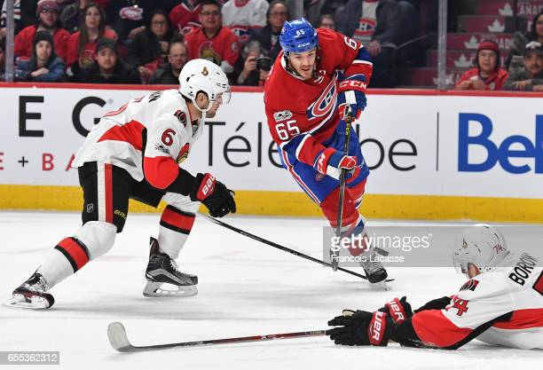 Andrew Shaw of the Montreal Canadiens ad Chris Wideman of the Ottawa Senators fight for the puck in the NHL game at the Bell Centre on March 19 2017...