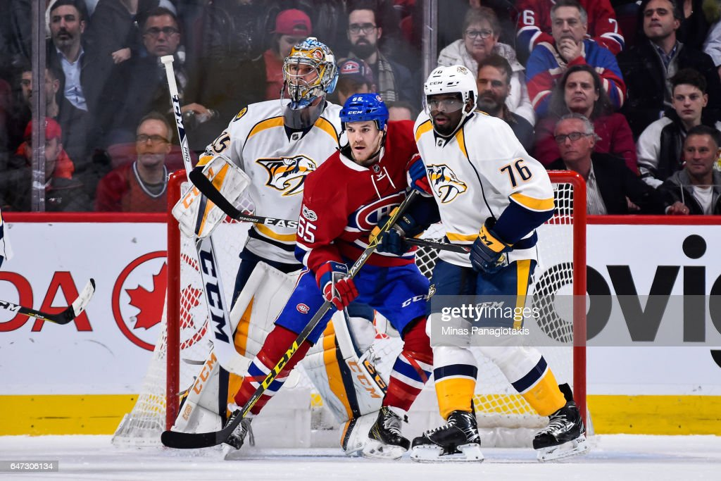 Andrew Shaw #65 of the Montreal Canadiens and P.K. Subban #76 of the Nashville Predators battle for position in front of goaltender Pekka Rinne #35 during the NHL game at the Bell Centre on March 2, 2017 in Montreal, Quebec, Canada. The Montreal Canadiens defeated the Nashville Predators 2-1.