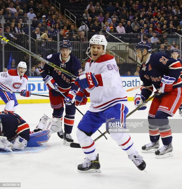 Andrew Shaw of the Montreal Canadiens celebrates his goal at 355 of the first period against Henrik Lundqvist of the New York Rangers at Madison...