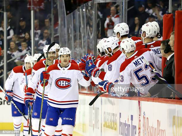 Andrew Shaw of the Montreal Canadiens celebrates his second period goal against the Winnipeg Jets with teammates at the bench at the Bell MTS Place...