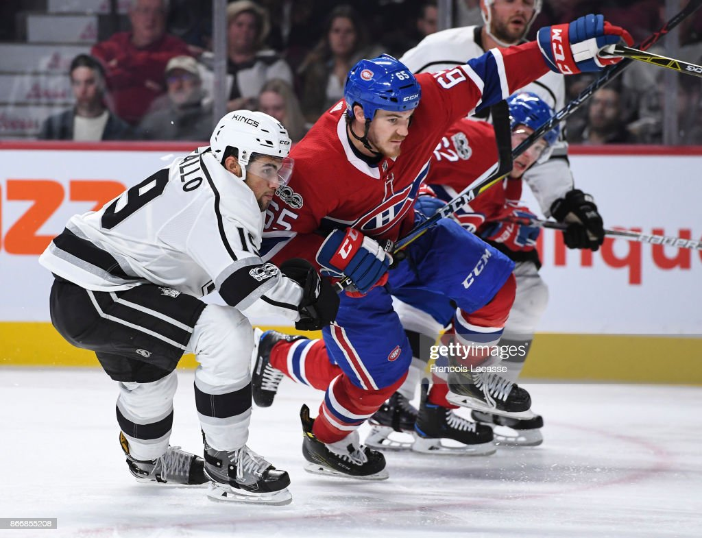 Andrew Shaw #65 of the Montreal Canadiens fights for position on his 400th NHL game, against Alex Iafallo #19 of the Los Angeles Kings in the NHL game at the Bell Centre on October 26, 2017 in Montreal, Quebec, Canada.