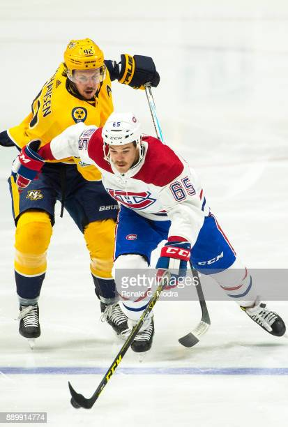 Andrew Shaw of the Montreal Canadiens skates as Jonathan Drouin of the Nashville Predators chases during an NHL game at Bridgestone Arena on November...