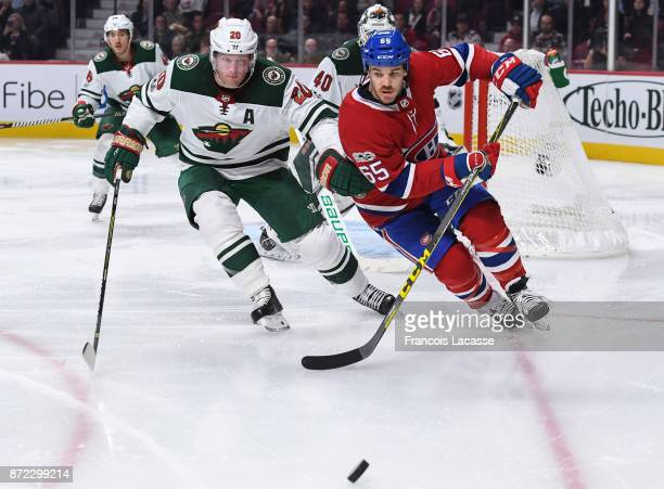 Andrew Shaw of the Montreal Canadiens skates for the puck against Ryan Suter of the Minnesota Wild in the NHL game at the Bell Centre on November 9...