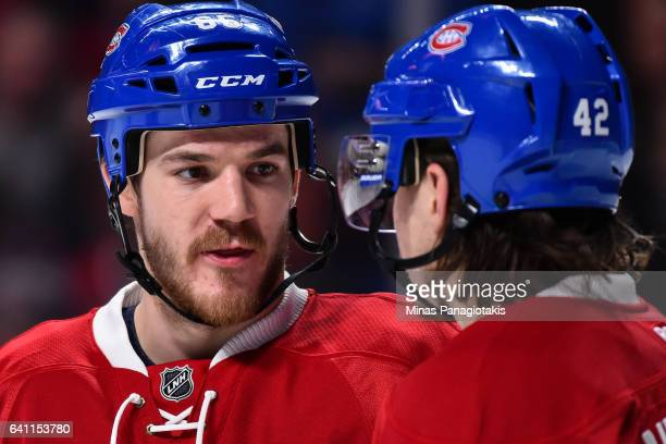 Andrew Shaw of the Montreal Canadiens speaks with teammate Sven Andrighetto during the NHL game against the Washington Capitals at the Bell Centre on...