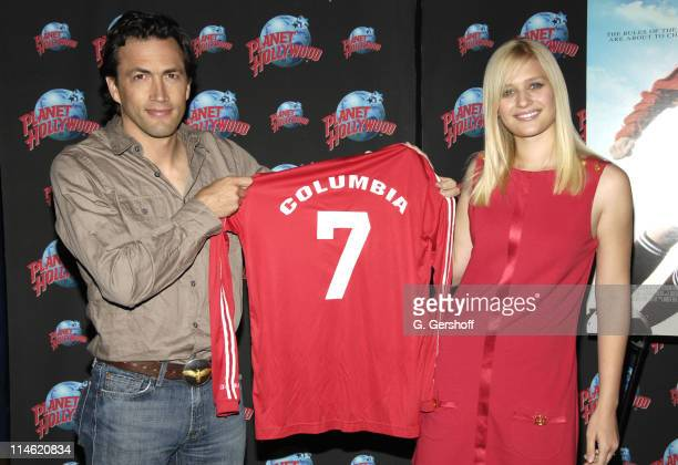 Andrew Shue and Carly Schroeder during 'Gracie' Cast Members Carly Schroder and Andrew Shue Donate Memorabilia to Planet Hollywood at Planet...