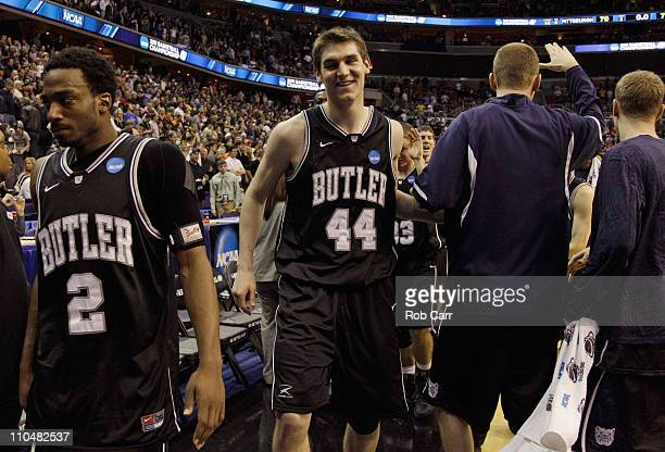 Andrew Smith of Butler and teammate Shawn Vanzant walk off the court after Butler's victory of Pittsburgh in the third round of the 2011 NCAA men's...