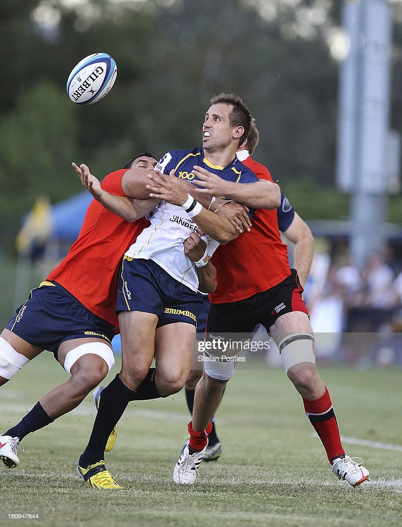 Andrew Smith of the Brumbies juggles a loose ball during the Super Rugby trial match between the Brumbies and the ACT XV at Viking Park on February 8, 2013 in Canberra, Australia.