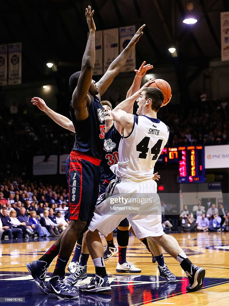 Andrew Smith of the Butler Bulldogs tries to pass off the ball as Sam Dower of the Gonzaga Bulldogs guards at Hinkle Fieldhouse on January 19 2013 in...