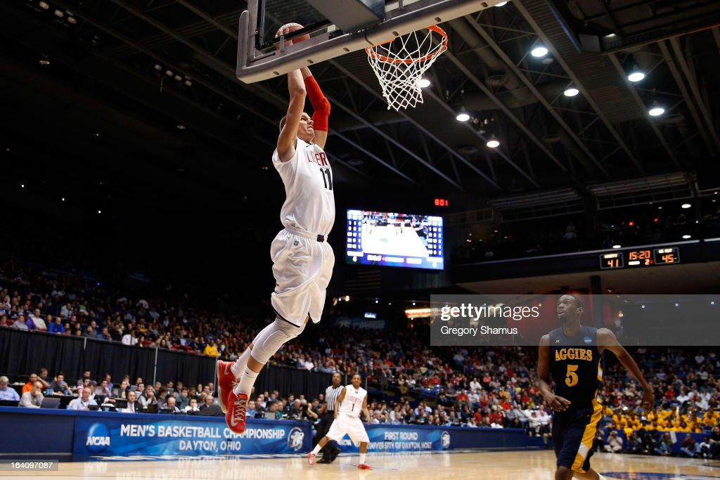 <a gi-track='captionPersonalityLinkClicked' href=/galleries/search?phrase=Andrew+Smith+-+Basketball+Player&family=editorial&specificpeople=7641849 ng-click='$event.stopPropagation()'>Andrew Smith</a> #11 of the Liberty Flames dunks in the second half against Jean Louisme #5 of the North Carolina A&T Aggies during the first round of the 2013 NCAA Men's Basketball Tournament at University of Dayton Arena on March 19, 2013 in Dayton, Ohio.