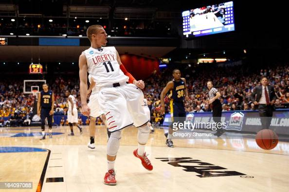 Andrew Smith of the Liberty Flames reacts after he dunked in the second half against the North Carolina AT Aggies during the first round of the 2013...