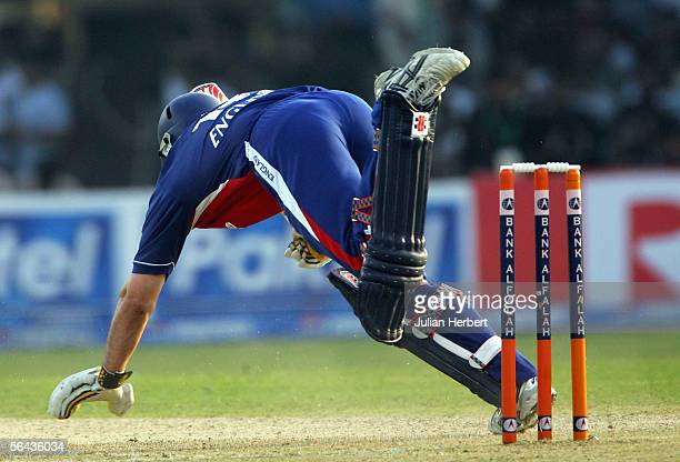 Andrew Starauss stumbles as he is out LBW during the 3rd One Day International between Pakistan and England played at The National Stadium on...