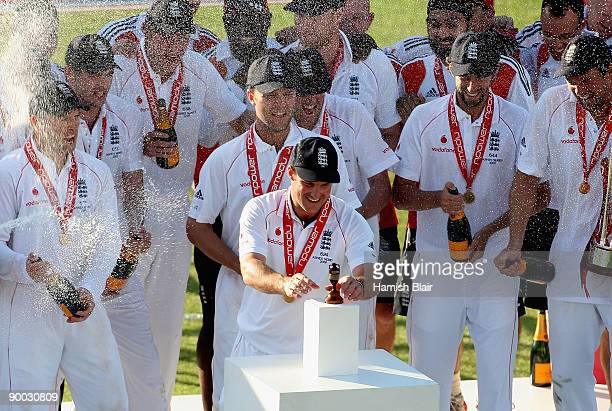 Andrew Strauss captain of England collects the replica urn during the presentations after day four of the npower 5th Ashes Test Match between England...