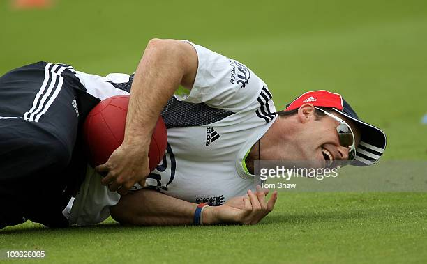 Andrew Strauss of England catches a medicine ball during the England nets session at Lords on August 25 2010 in London England