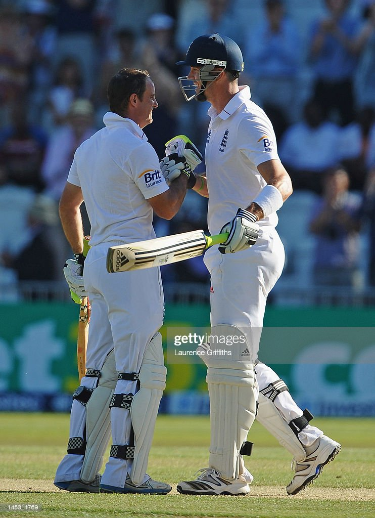 Andrew Strauss of England celebrates his century with Kevin Pietersen during the Second Investec Test match between England and West Indies at Trent Bridge on May 26, 2012 in Nottingham, England.