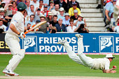 Andrew Strauss of England dives to catch Adam Gilchrist of Australia during day three of the Fourth npower Ashes Test between England and Australia...