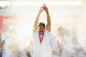 Andrew Strauss of England lifts the Ashes urn after day four of the npower 5th Ashes Test Match between England and Australia at The Brit Oval on...