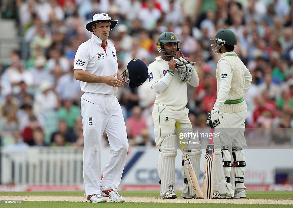 Andrew Strauss of England looks dejected as Imran Farhat and Salman Butt (R) of Pakistan talk during day four of the npower 3rd Test Match between England and Pakistan at The Brit Insurance Oval on August 21, 2010 in London, England.