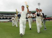 Andrew Strauss of England raises his bat as he leaves the field after England win the first Test Match between South Africa and England at StGeorges...