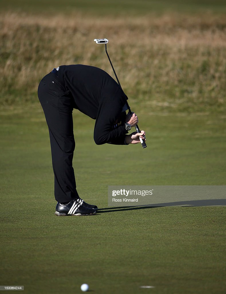 Andrew Strauss the rormer England test cricketer reacts to a missed putt on the 8th green during the first round of The Alfred Dunhill Links Championship at The Old Course on October 4, 2012 in St Andrews, Scotland.