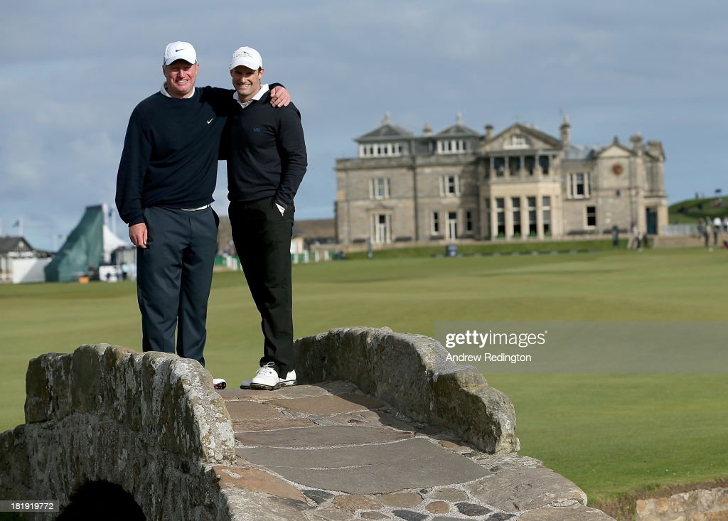 Andrew Strauss with his playing parter Richard Finch pose for a photograph on the Swilken Bridge on the 18th hole during the first round of the Alfred Dunhill Links Championship on The Old Course, at St Andrews on September 26, 2013 in St Andrews, Scotland.