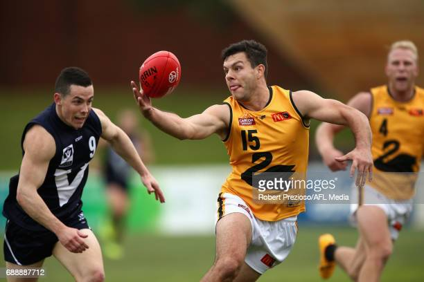 Andrew Strijk of WAFL gathers the ball during the match between VFL and WAFL at North Port Oval on May 27 2017 in Melbourne Australia