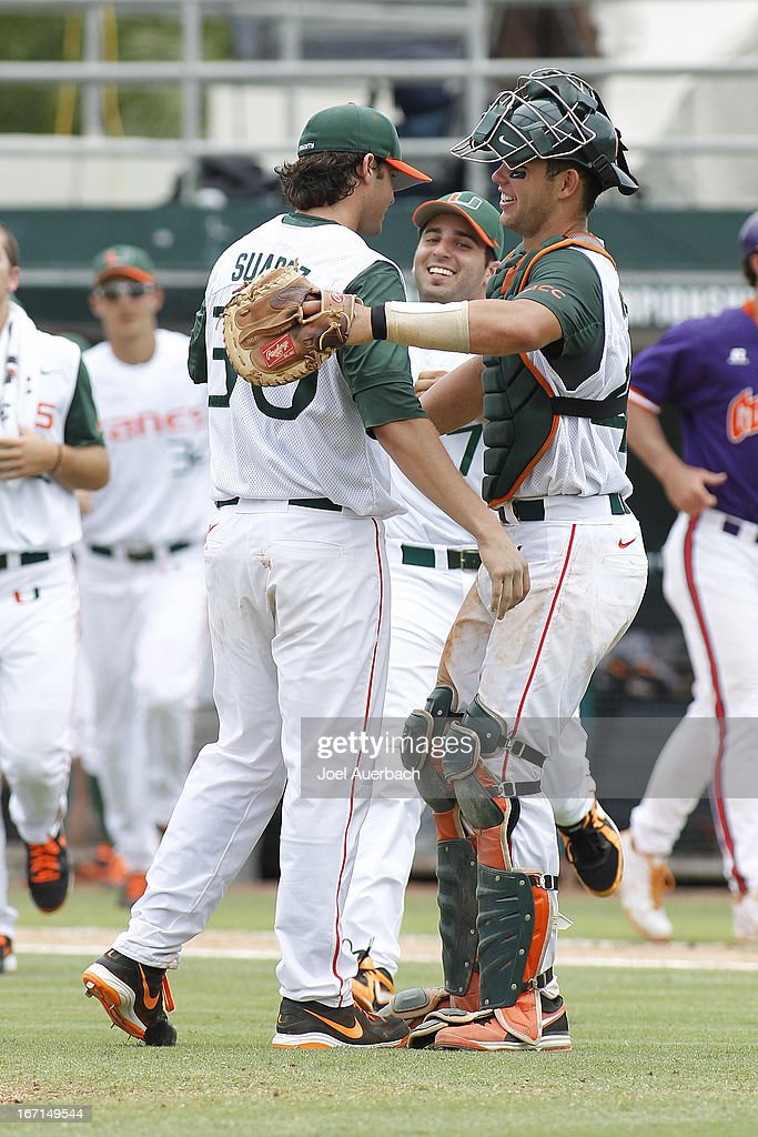Andrew Suarez #30 is congratulated by Garrett Kennedy #40 of the Miami Hurricanes after the final out of the game against the Clemson Tigers on April 21, 2013 at Alex Rodriguez Park at Mark Light Field in Coral Gables, Florida. Miami defeated Clemson 7-0.