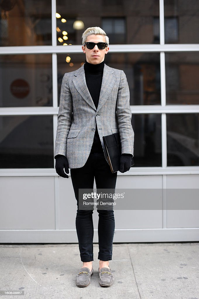 Andrew Sulzer from Brooklyn is seen wearing Ray Ban sunglasses, vintage jacket, Levis pants and YSL shoes on February 6, 2013 in New York City.