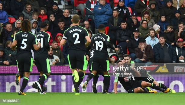 Andrew Surman of AFC Bournemouth celebrates scoring the first Bournemouth goal with team mates during the Premier League match between Stoke City and...