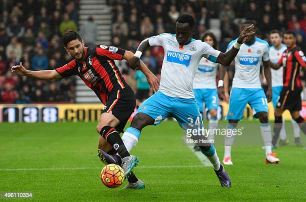 Andrew Surman of Bournemouth and Cheik Ismael Tiote of Newcastle United compete for the ball during the Barclays Premier League match between AFC...