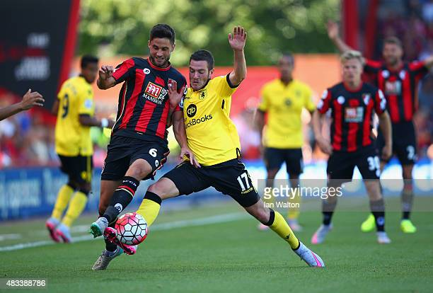 Andrew Surman of Bournemouth and Jordan Veretout of Aston Villa compete for the ball during the Barclays Premier League match between AFC Bournemouth...