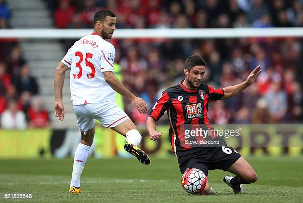 Andrew Surman of Bournemouth tackles Kevin Stewart of Liverpool during the Barclays Premier League match between AFC Bournemouth and Liverpool at the...