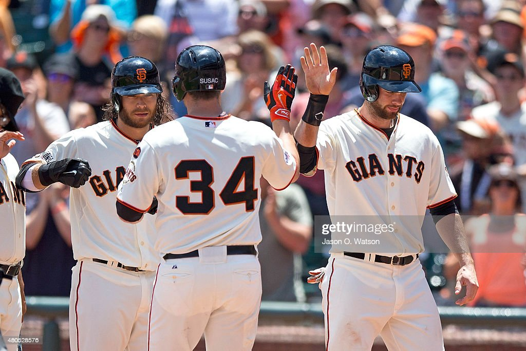 Andrew Susac #34 of the San Francisco Giants is congratulated by Brandon Belt #9 and Brandon Crawford #35 after hitting a three run home run against the Philadelphia Phillies during the fourth inning at AT&T Park on July 12, 2015 in San Francisco, California. The San Francisco Giants defeated the Philadelphia Phillies 4-2.