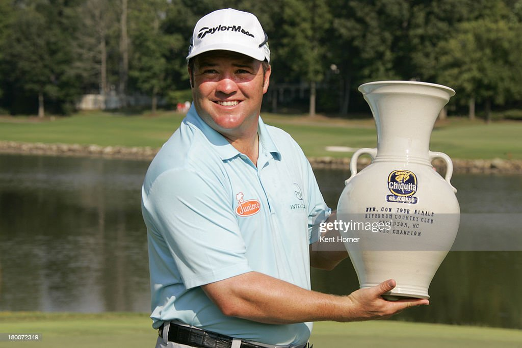 Andrew Svoboda holds the tournament's champion trophy after winning on the first play-off hole during the final round of the Chiquita Classic in the Web.com tour finals at River Run Country Club on September 8, 2013 in Davidson, North Carolina.