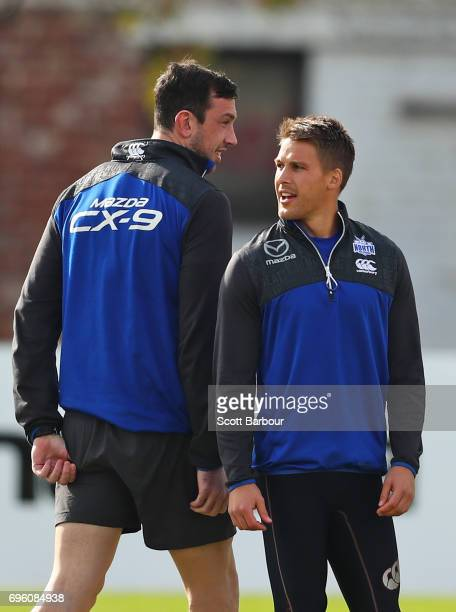 Andrew Swallow of the Kangaroos and Todd Goldstein talk during a North Melbourne Kangaroos AFL training session at Arden Street Ground on June 15...