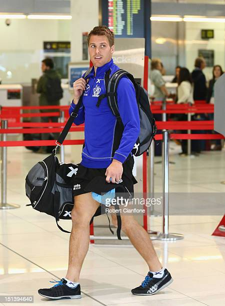 Andrew Swallow of the Kangaroos arrives at Melbourne Airport on September 7 2012 in Melbourne Australia