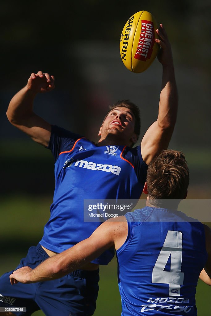 <a gi-track='captionPersonalityLinkClicked' href=/galleries/search?phrase=Andrew+Swallow&family=editorial&specificpeople=608525 ng-click='$event.stopPropagation()'>Andrew Swallow</a> of the Kangaroos gathers the ball during a North Melbourne Kangaroos AFL media session at Arden Street Ground on May 5, 2016 in Melbourne, Australia.