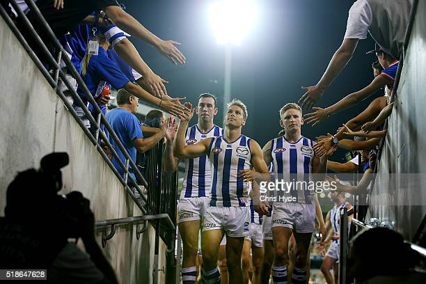Andrew Swallow of the Kangaroos leads the lead after winning the round two AFL match between the Brisbane Lions and the North Melbourne Kangaroos at...