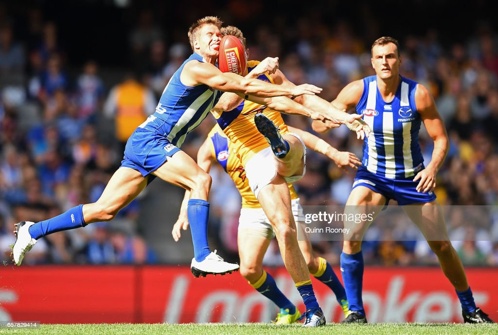 Andrew Swallow of the Kangaroos smouthers a kick by Drew Petrie of the Eagles during the round one AFL match between the North Melbourne Kangaroos and the West Coast Eagles at Etihad Stadium on March 26, 2017 in Melbourne, Australia.