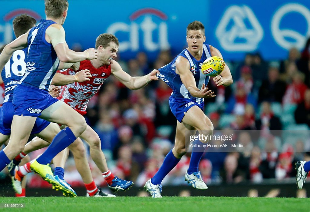 <a gi-track='captionPersonalityLinkClicked' href=/galleries/search?phrase=Andrew+Swallow&family=editorial&specificpeople=608525 ng-click='$event.stopPropagation()'>Andrew Swallow</a> of the Roos in action during the 2016 AFL Round 10 match between the Sydney Swans and the North Melbourne Kangaroos at the Sydney Cricket Ground on May 27, 2016 in Sydney, Australia.