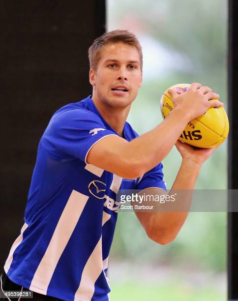 Andrew Swallow passes the ball during a North Melbourne Kangaroos AFL training session at Arden Street Ground on June 3 2014 in Melbourne Australia